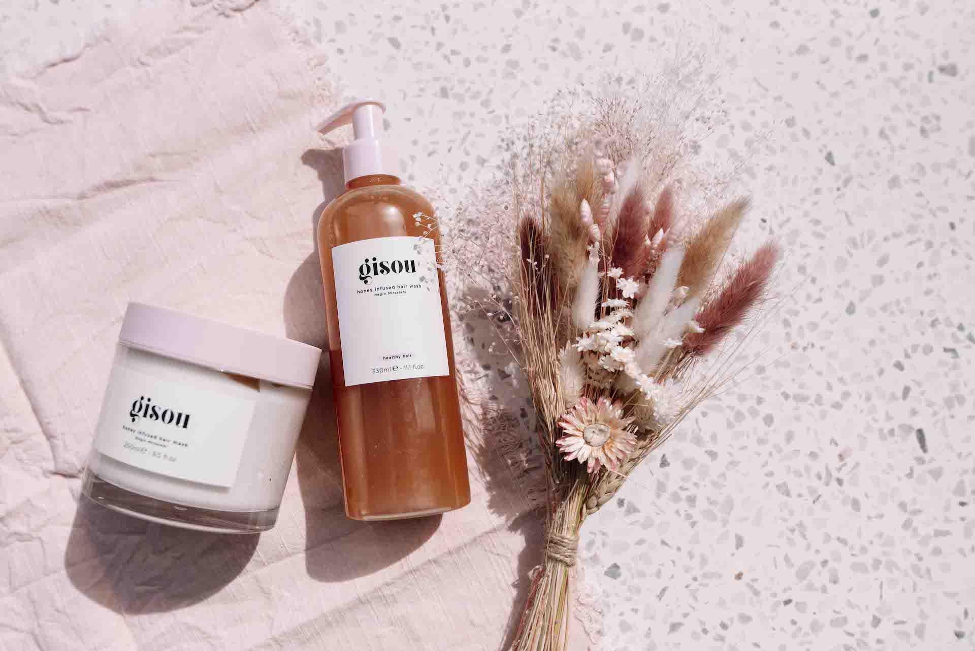 Gisou Hair Review - GLW; Click here to see the Gisou Hair review on Girls Living Well! Best gisou hair oil review with gisou hair oil results. gisou products packaging are super cute and stylish on the counter in the bathroom. This is a review of the gisou hair perfume, as well as the gisou honey infused hair mask. These are truly the ultimate and absolute best natural haircare products. Hair products for curly hair. Hair products for fine hair.